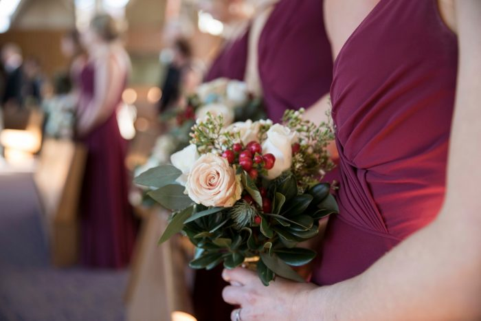 Red and White Bridesmaids Bouquets: Warm December Embassy Suites Wedding from Dorosh Documentaries featured on Burgh Brides