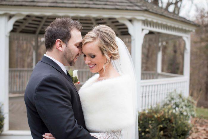 Faux Fur Bridal Wrap: Warm December Embassy Suites Wedding from Dorosh Documentaries featured on Burgh Brides
