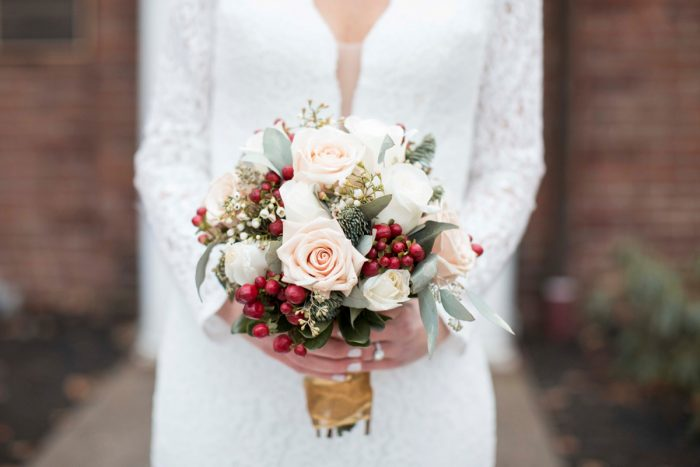 Winter Bridal Bouquet: Warm December Embassy Suites Wedding from Dorosh Documentaries featured on Burgh Brides