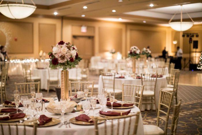 Gold Wedding Centerpieces: Warm December Embassy Suites Wedding from Dorosh Documentaries featured on Burgh Brides