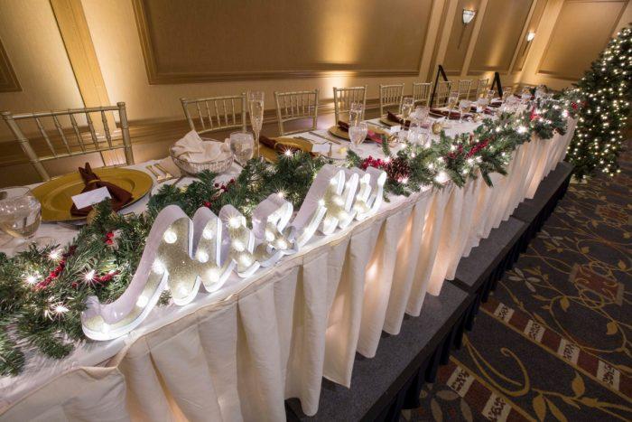 Christmas Wedding Head Table: Warm December Embassy Suites Wedding from Dorosh Documentaries featured on Burgh Brides