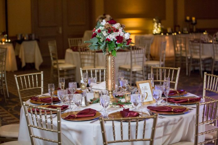Red and White Wedding Centerpieces on Gold Stands: Warm December Embassy Suites Wedding from Dorosh Documentaries featured on Burgh Brides