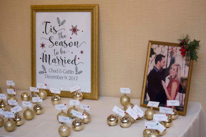 Christmas Bulbs Wedding Escort Cards: Warm December Embassy Suites Wedding from Dorosh Documentaries featured on Burgh Brides