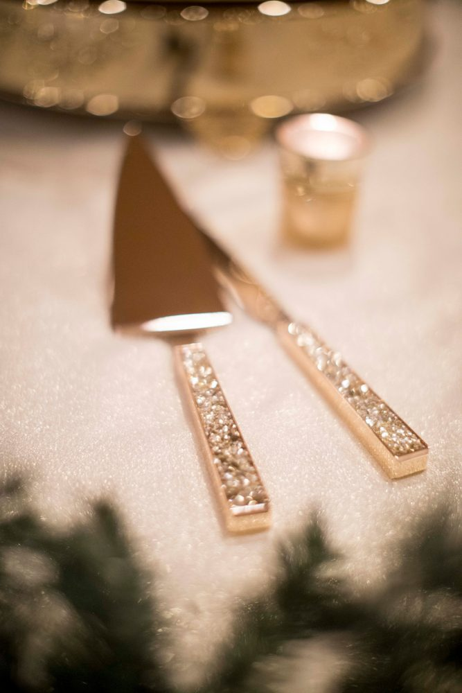 Gold Wedding Cake Knives: Warm December Embassy Suites Wedding from Dorosh Documentaries featured on Burgh Brides
