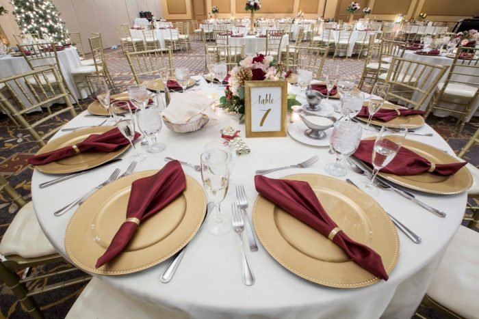 Gold Chargers with Burgundy Napkins: Warm December Embassy Suites Wedding from Dorosh Documentaries featured on Burgh Brides