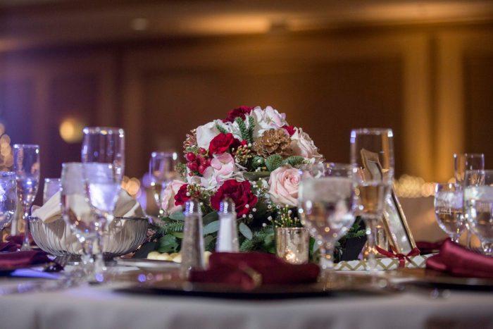 Christmas Wedding Centerpieces: Warm December Embassy Suites Wedding from Dorosh Documentaries featured on Burgh Brides
