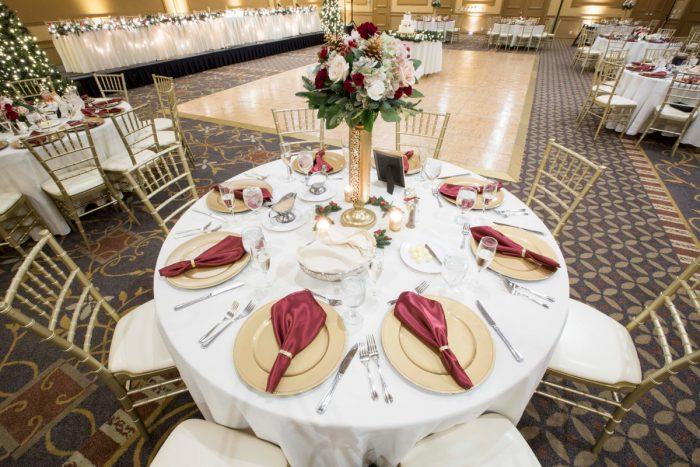 Burgundy and Gold Wedding Decor: Warm December Embassy Suites Wedding from Dorosh Documentaries featured on Burgh Brides