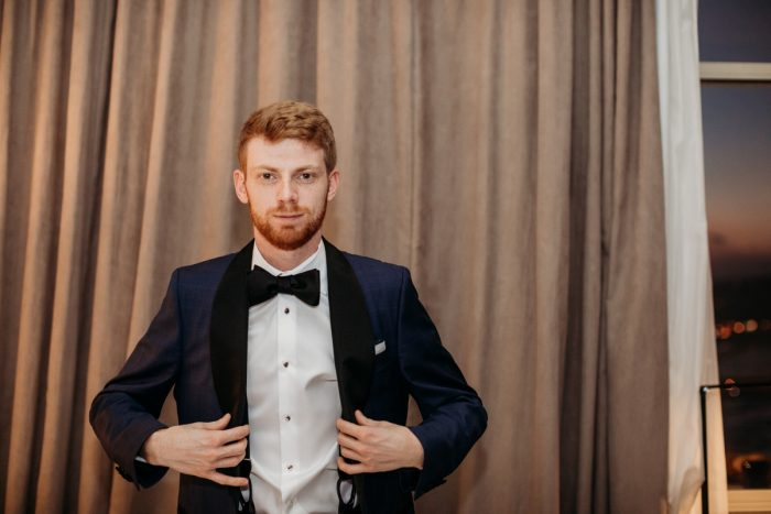 Black and white tuxedo on groom: Art Deco New Years Eve Pittsburgh Renaissance Hotel Wedding from Tyler Norman Photography featured on Burgh Brides