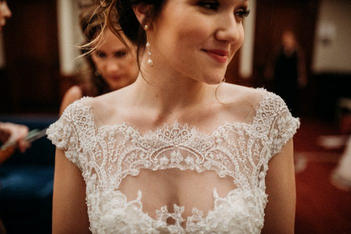 Lace key hole wedding dress: Art Deco New Years Eve Pittsburgh Renaissance Hotel Wedding from Tyler Norman Photography featured on Burgh Brides