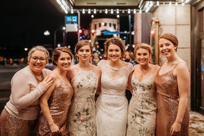 Floral and sequins mismatched bridesmaids dresses: Art Deco New Years Eve Pittsburgh Renaissance Hotel Wedding from Tyler Norman Photography featured on Burgh Brides