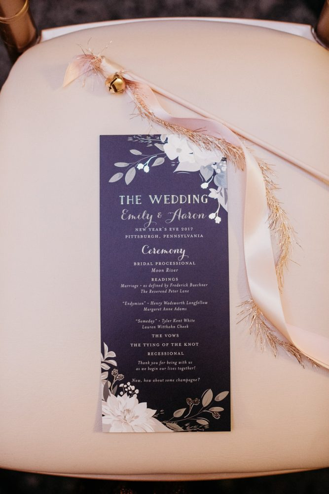 Floral wedding ceremony programs: Art Deco New Years Eve Pittsburgh Renaissance Hotel Wedding from Tyler Norman Photography featured on Burgh Brides