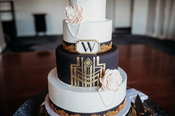 Art deco wedding cake: Art Deco New Years Eve Pittsburgh Renaissance Hotel Wedding from Tyler Norman Photography featured on Burgh Brides