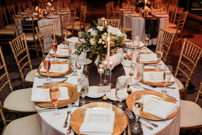 Oval shaped wedding tables: Art Deco New Years Eve Pittsburgh Renaissance Hotel Wedding from Tyler Norman Photography featured on Burgh Brides
