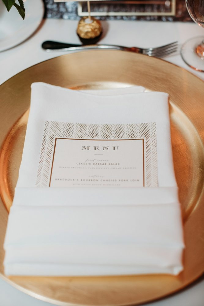 Art deco wedding menu cards: Art Deco New Years Eve Pittsburgh Renaissance Hotel Wedding from Tyler Norman Photography featured on Burgh Brides