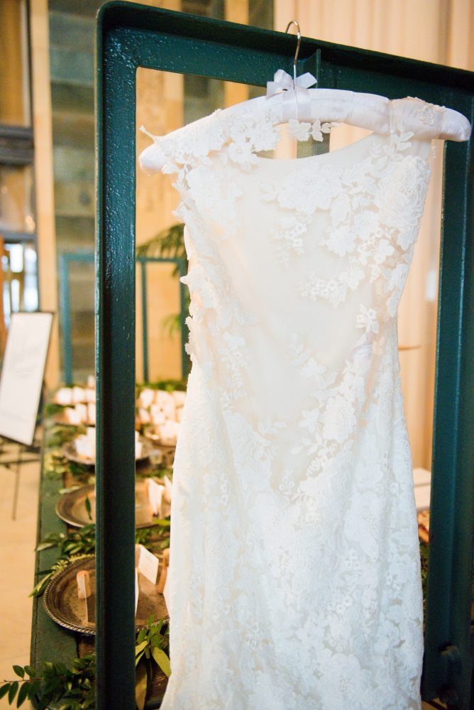 Lace Cap Sleeve Wedding Dress on Hanger: Amalfi Coast Inspired Wedding at The Pennsylvanian from Bumbleburgh Events & Leeann Marie Photography featured on Burgh Brides