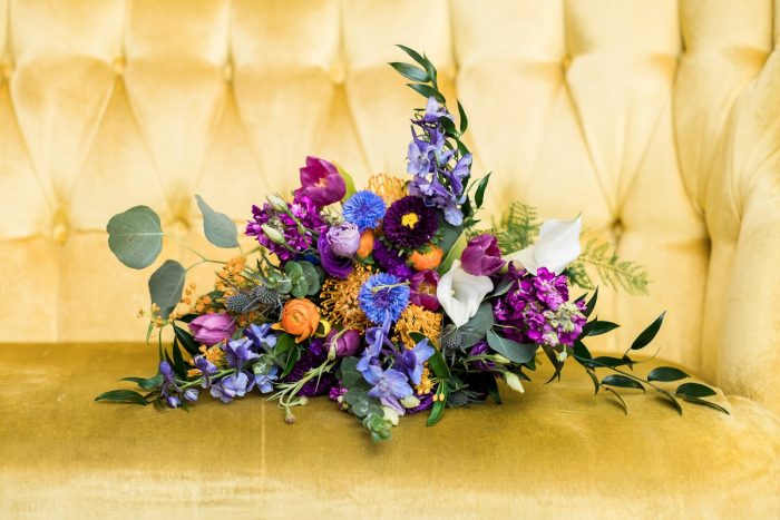Purple, Blue, & Yellow Bridal Bouquet: Cool & Colorful Surprise Warhol Museum Wedding from Caitlin's Living Photography and Exhale Events featured on Burgh Brides
