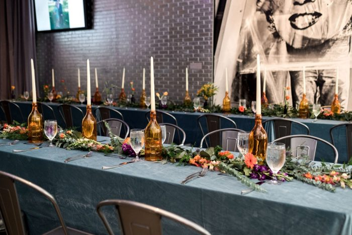 Long Table Blue Linen Amber Wine Bottle Centerpieces: Cool & Colorful Surprise Warhol Museum Wedding from Caitlin's Living Photography and Exhale Events featured on Burgh Brides