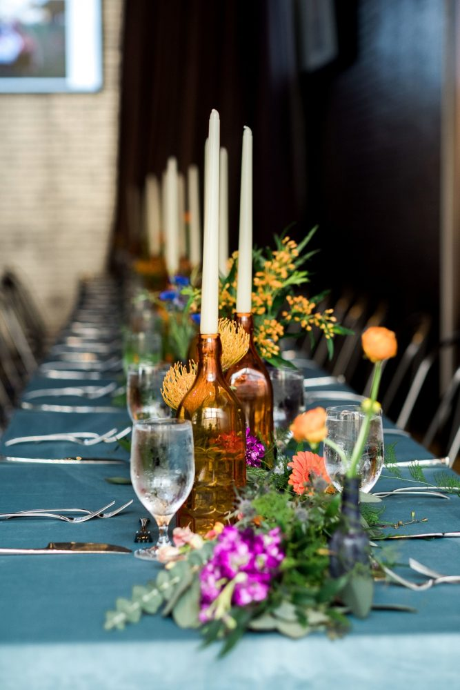 Long Table Amber Wine Bottle Centerpieces: Cool & Colorful Surprise Warhol Museum Wedding from Caitlin's Living Photography and Exhale Events featured on Burgh Brides