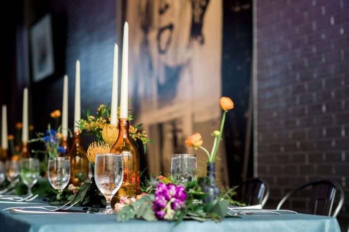 Upcycled Wine Bottle Centerpieces: Cool & Colorful Surprise Warhol Museum Wedding from Caitlin's Living Photography and Exhale Events featured on Burgh Brides