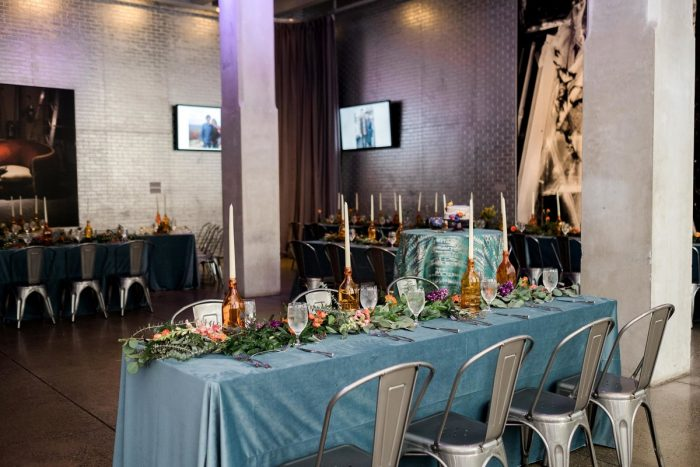 Long Tables Metal Chairs Upcycled Wine Bottle Centerpieces: Cool & Colorful Surprise Warhol Museum Wedding from Caitlin's Living Photography and Exhale Events featured on Burgh Brides