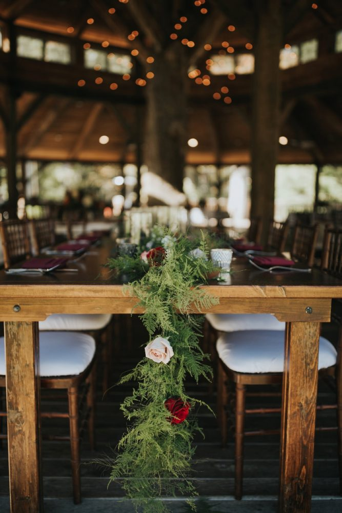 Wooden Tables with Floral and Greenery Runner: FALL in Love with This Enchanting Fernstone Wedding from Oakwood Photo + Video featured on Burgh Brides