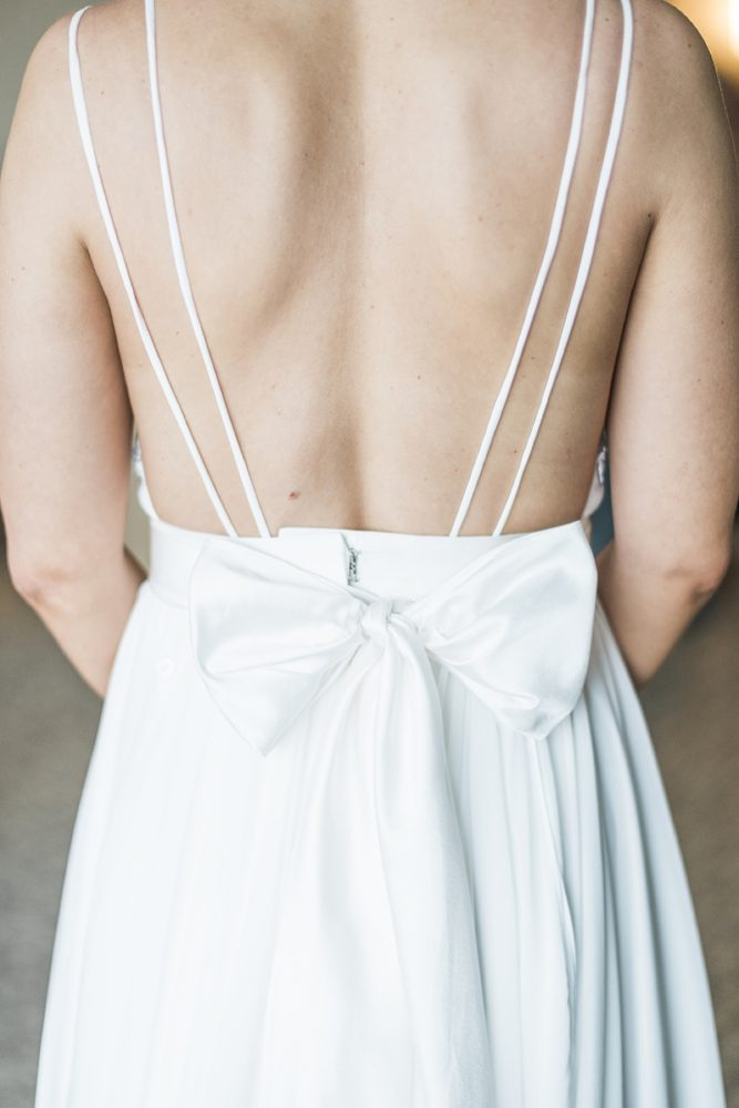 Bow Wedding Dress Back: Soft & Neutral Wedding at The Pennsylvanian from Levana Melamed Photography featured on Burgh Brides