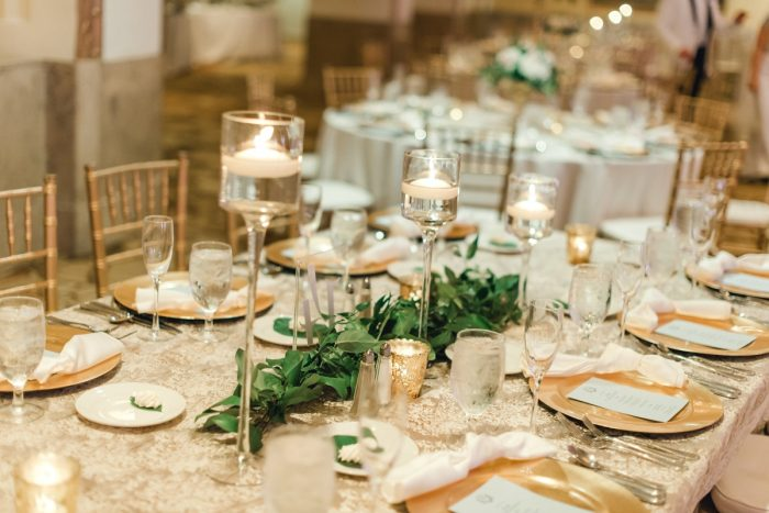 Floating candles glass hurricanes greenery table runner: Timeless & Elegant Omni William Penn Wedding from Dawn Derbyshire Photography & Olive & Rose Events