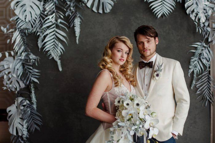 Groom in Ivory Tuxedo Jacket Bride Anemone Bouquet: Gray & White Wedding Inspired Styled Shoot from Michael Will Photographers