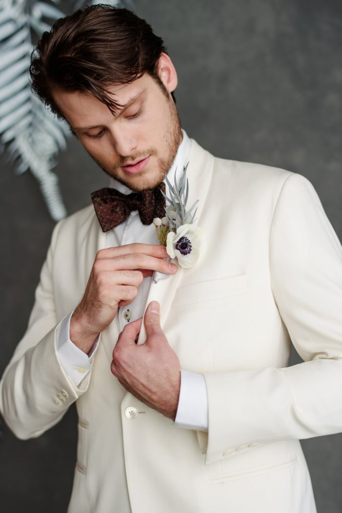 Groom ivory tuxedo jacket black bow tie: Gray & White Wedding Inspired Styled Shoot from Michael Will Photographers