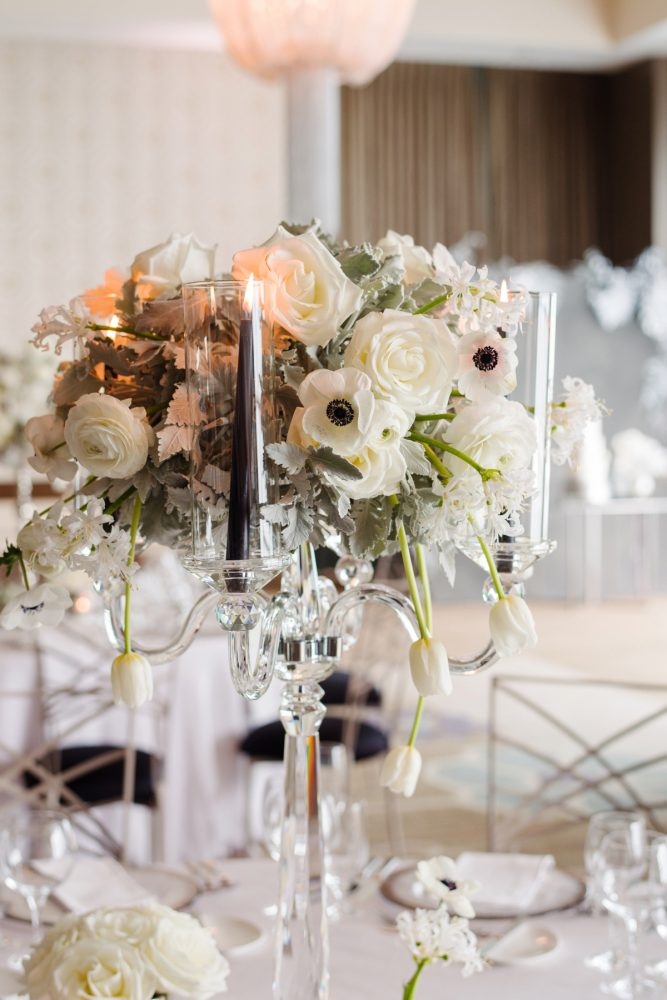 Wedding centerpieces white anemones roses orchids dusty miller black taper candles: Gray & White Wedding Inspired Styled Shoot from Michael Will Photographers