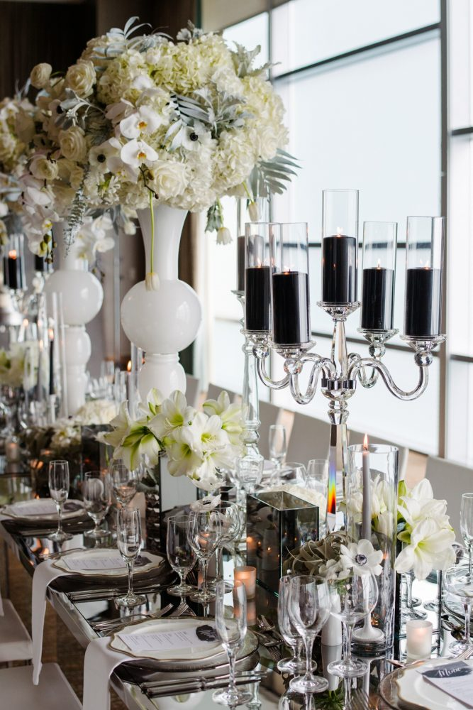 Clear crystal candelabras black pillar candles mirror table top white and gray wedding flowers: Gray & White Wedding Inspired Styled Shoot from Michael Will Photographers