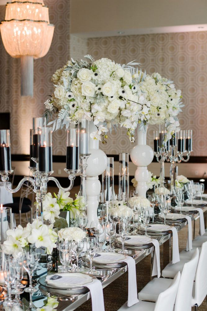 White roses orchids anemones wedding flowers clear crystal candelabras black pillar candles: Gray & White Wedding Inspired Styled Shoot from Michael Will Photographers