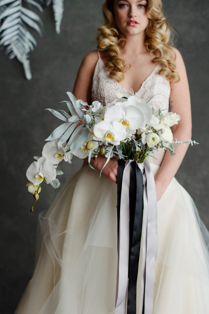 Wedding bouquet black and white ribbons white orchids: Gray & White Wedding Inspired Styled Shoot from Michael Will Photographers
