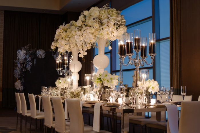 Tall white vases centerpieces anemones orchids roses black pillar candles: Gray & White Wedding Inspired Styled Shoot from Michael Will Photographers