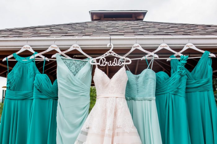 Mismatched teal bridesmaids dresses: Whimsical Teal Antonelli Event Center Wedding