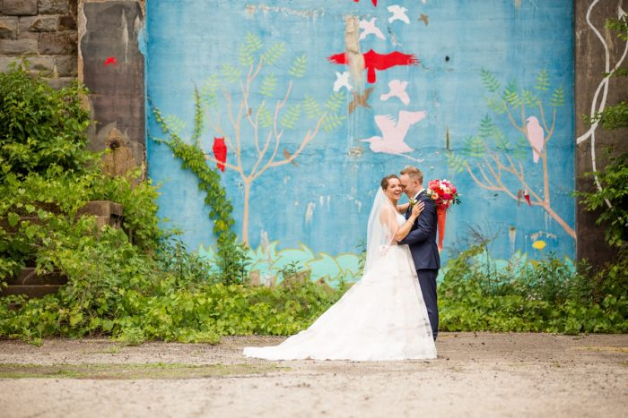 Colorful painted mural wedding portraits backdrop: Whimsical Teal Antonelli Event Center Wedding