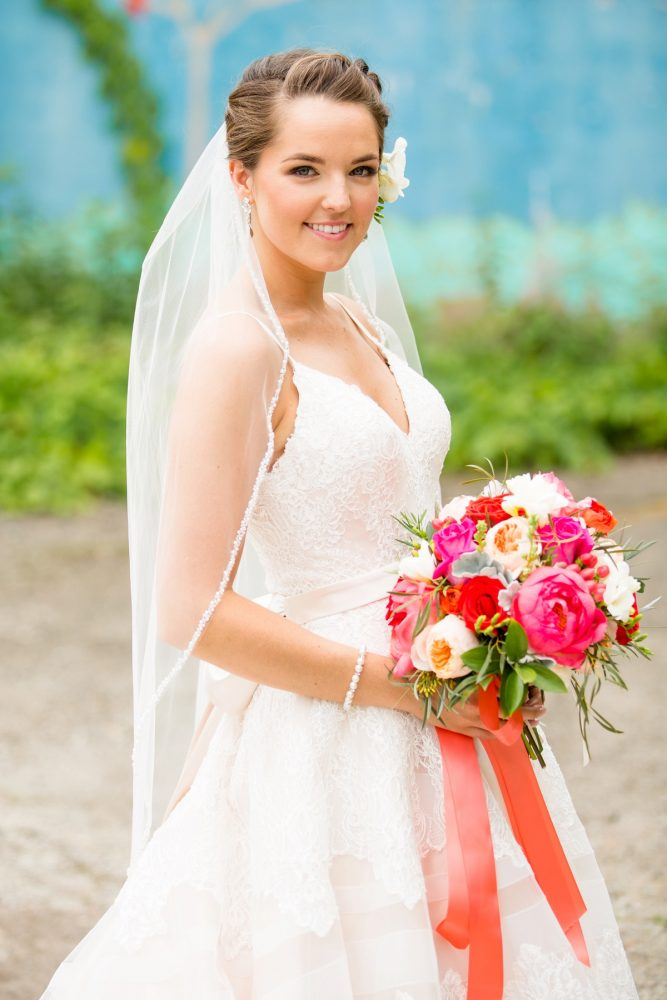 Bride spaghetti strap wedding dress pink and orange bouquet satin ribbons: Whimsical Teal Antonelli Event Center Wedding