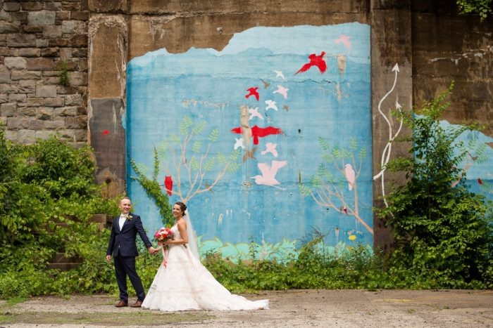 Colorful painted mural bride and groom wedding portraits: Whimsical Teal Antonelli Event Center Wedding