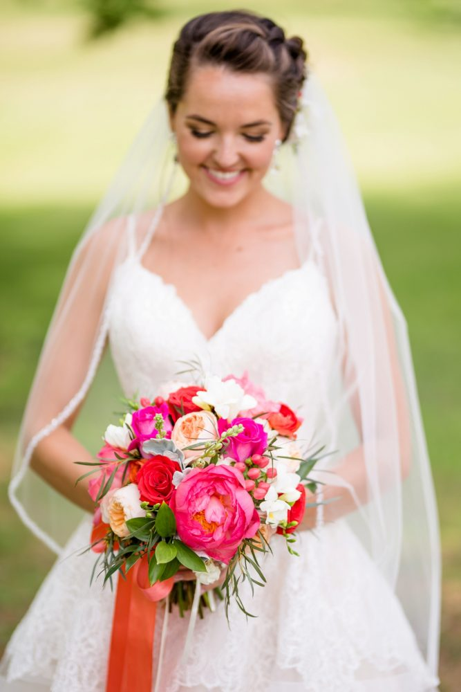 Pink and orange bridal bouquet spaghetti strap wedding dress: Whimsical Teal Antonelli Event Center Wedding