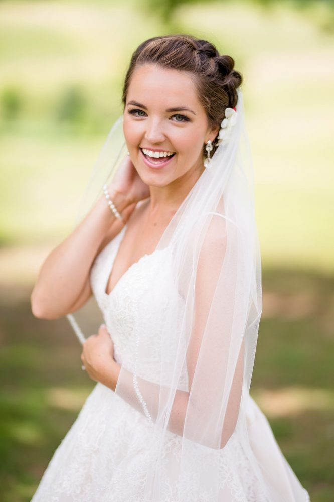 Bride spaghetti strap wedding dress veil: Whimsical Teal Antonelli Event Center Wedding