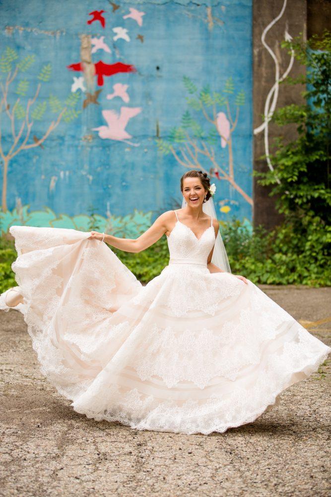 Spaghetti strap wedding dress lace stripes: Whimsical Teal Antonelli Event Center Wedding