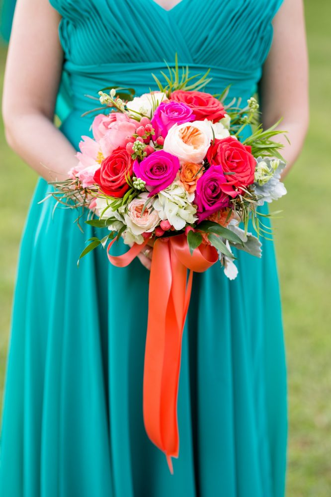 Teal bridesmaids dress pink flowers orange satin ribbon: Whimsical Teal Antonelli Event Center Wedding
