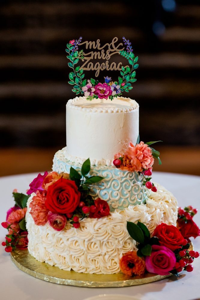 Buttercream wedding cake fresh flowers wooden cake topper: Whimsical Teal Antonelli Event Center Wedding