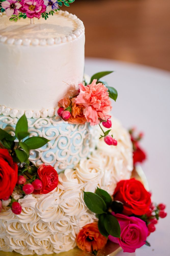 Buttercream wedding cake fresh flowers: Whimsical Teal Antonelli Event Center Wedding