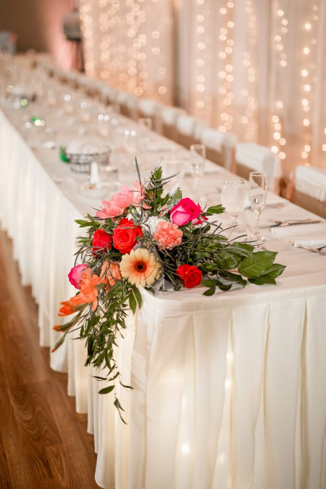 Orange and pink wedding flowers wedding head table: Whimsical Teal Antonelli Event Center Wedding