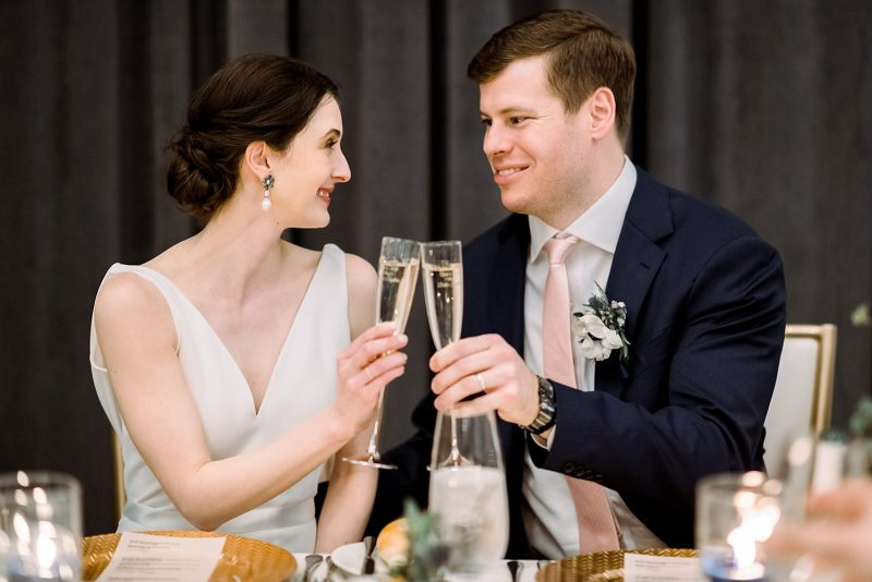 Bride and groom toasting with champagne flutes