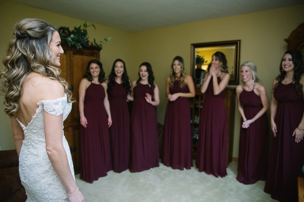 Bride doing first look with bridesmaids