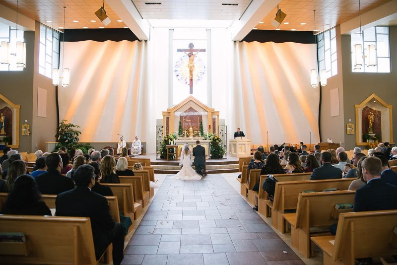Bride and groom at altar during wedding ceremony