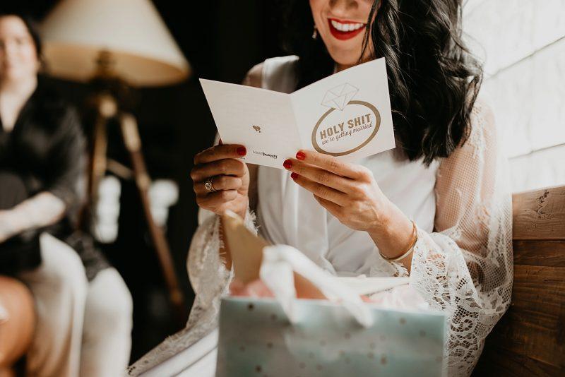 Bride reading card on wedding day