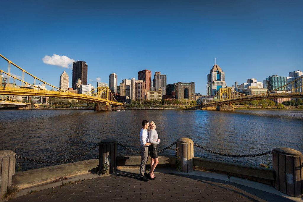 North Shore Engagement Session with City Skyline Views. For more Pittsburgh engagement photo ideas, visit burghbrides.com!